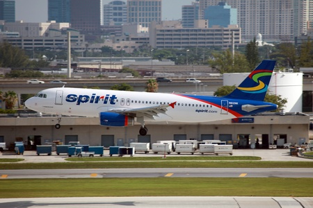 Fort Lauderdale, Florida - May 10, 2012: A Spirit Airlines Airbus A320 approaches Fort Lauderdale Airport in Florida. Spirit Airlines is a low-cost carrier with its operating base in Fort Lauderdale. It operates with 40 aircraft.