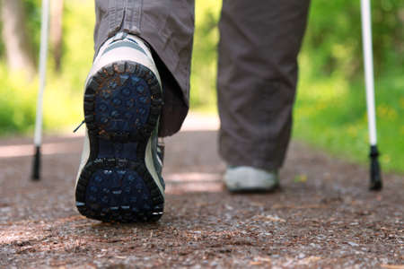 freetime activity: Sole of a hiking shoe during a Nordic Walking tour