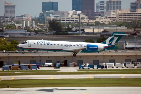 Fort Lauderdale, Florida - May 10, 2012: An AirTran Boeing 717 approaches Fort Lauderdale Airport in Florida. AirTran is an American low-cost airline headquartered in Orlando, Florida. It is a subsidiary of Southwest Airlines. AirTran operates with 140 pl