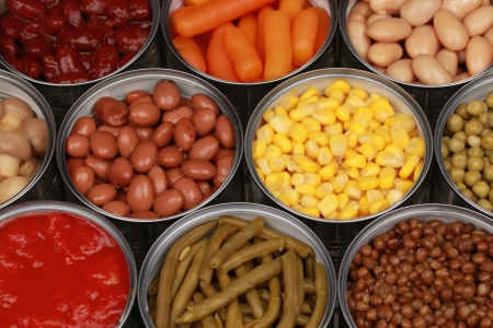 canned peas: Different kinds of vegetables such as corn, peas and tomatoes in cans