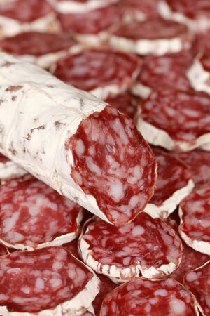 Original Salami from Italy with slices as background photo