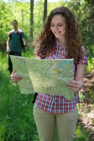 freetime activity: A hiker is reading a map for orientation  Stock Photo