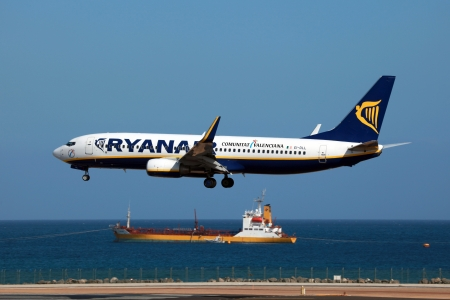lanzarote: Lanzarote, Spain - October 8, 2011: A Ryanair Boeing 737-800 approaches Lanzarote Airport in Spain. Ryanair is a low-cost airline from Ireland, headquartered in Dublin. It is Europes largest airline with 294 planes and 76.4 million passengers in 2011.  Editorial
