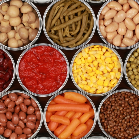 Different kinds of vegetables such as corn, peas and tomatoes in cans photo