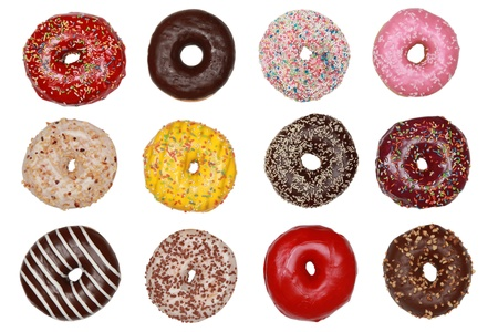 Collection of many colored donuts side by side isolated on white photo