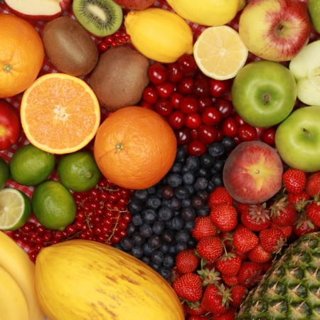 oranges: Fruit background with oranges, lemons, cherries, apples and strawberries Stock Photo