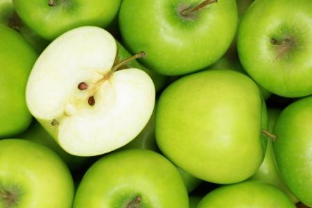 manzana: Grupo de manzanas verdes formando un fondo