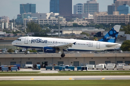 Fort Lauderdale, Florida - May 10, 2012  A jetBlue Airways Airbus A320 approaches Fort Lauderdale Airport in Florida  JetBlue Airways is an American low-cost carrier with its operating base at the John F  Kennedy International Airport in New York City  It