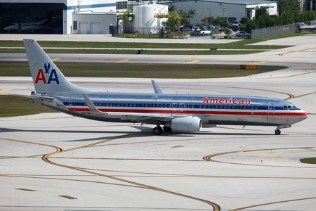 Fort Lauderdale, Florida - May 10, 2012  An American Airlines Boeing 737-800 with the registration N817NN taxis at Fort Lauderdale Airport in Florida  American Airlines operates with 608 aircraft  In 2010 it carried 86 1 million passengers  It is headquar Editorial