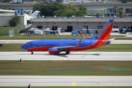 Fort Lauderdale, Florida, USA - May 10, 2012: A Southwest Airlines Boeing 737-700 with the registration N251WN taxis at Fort Lauderdale Airport (FLL) in Florida. Southwest Airlines is the worlds second largest airline and the largest low cost airline wit
