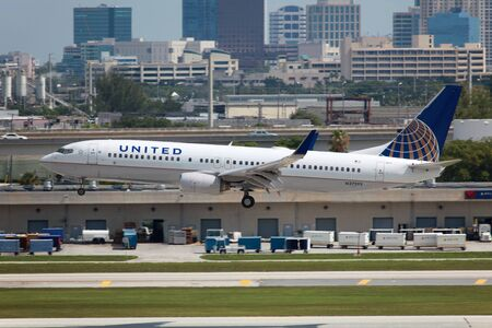 Fort Lauderdale, Florida, USA - May 10, 2012: A United Airlines Boeing 737-800 with the registration N37293 approaches Fort Lauderdale Airport in Florida. United Airlines is the worlds second largest airline with 701 planes and some 96 million passengers