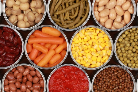 cans: Different kinds of vegetables such as corn, peas and tomatoes in cans