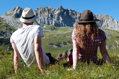 Young people make a short break during a hiking tour in the Austrian Alps Stock Photo