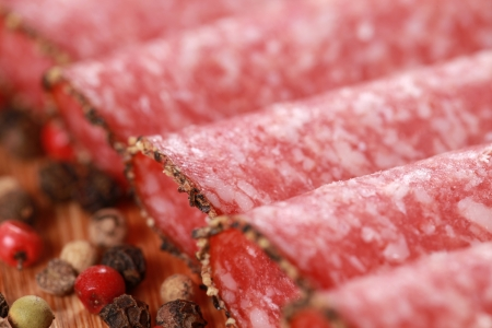 peppery: Salami in slices with peppery edge decorated with pepper Stock Photo