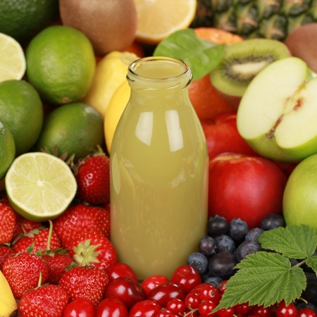 A bottle of kiwi and green apple smoothie surrounded by fresh fruits Stock Photo - 15016543