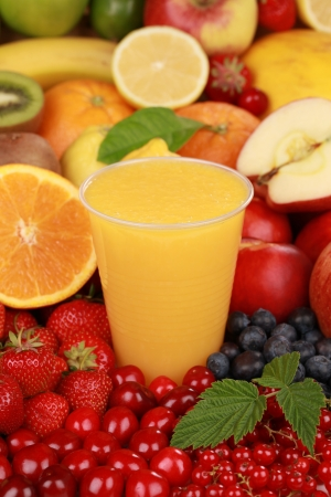 A glass of orange juice surrounded by fresh fruits Stock Photo - 15376437