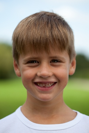 Portrait of a happy smiling young boy with tooth space Stock Photo