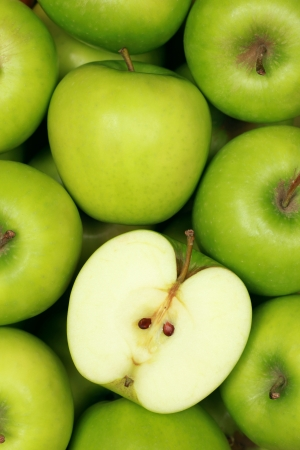 Group of green apples forming a background photo