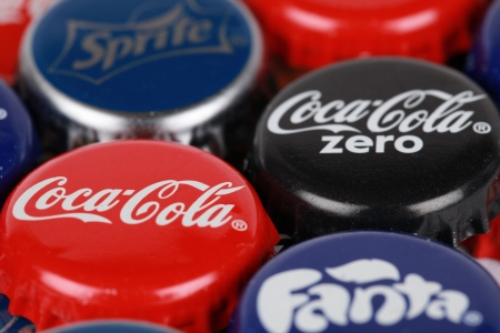 Stuttgart, Germany - October 6, 2012: Group of Coca-Cola, Coca-Cola Zero, Fanta and Sprite bottle caps. Macro shot with shallow depth of field.