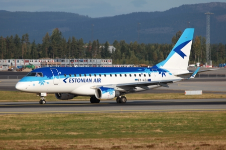 estonian: Oslo, Norway - September 16, 2012: An Estonian Air Embraer 170 jet airliner with the registration ES-AEA taxis at Oslo airport (OSL) in Norway. Estonian Air is the flag carrier airline of Estonia with a base at Tallinn airport. It operates with 11 aircraf Editorial
