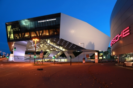 stuttgart: Stuttgart, Germany - October 3, 2012: Porsche Museum and a Porsche dealer in Stuttgart Zuffenhausen. Porsche is a German company with investments in the luxury automotive industry.