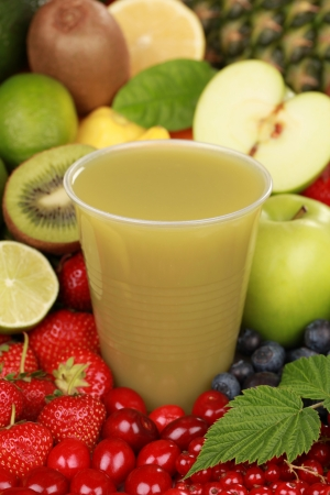 A cup of fresh kiwi and green apple smoothie surrounded by fresh fruits photo