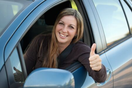 A happy driver leaning out of the window and showing thumbs up Stock Photo - 15769478