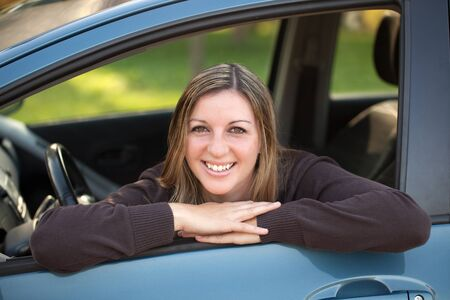 A happy driver leaning out of the window Stock Photo - 15785672