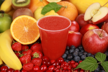 Freshly squeezed juice from red fruits in a cup