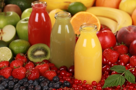 Fresh fruit juices made from red, green and orange fruits photo