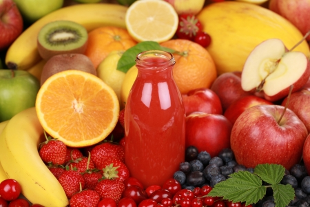 Freshly squeezed juice from red fruits in a bottle Stock Photo - 16213529