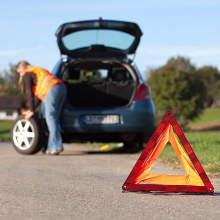 emergency vest: Broken down car with a red warning triangle Stock Photo