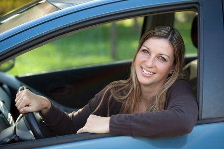 A relaxed driver leaning out of the window of the car Stock Photo - 16128853