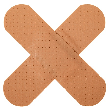 adhesive bandage: Patch in cross shape, isolated on white background