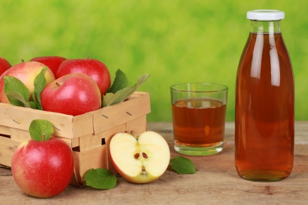 Fresh apple juice in a bottle and a glass next to ripe apples Stock Photo - 16481651