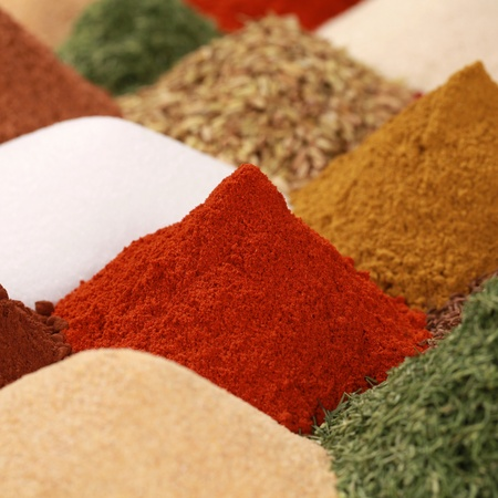 curry powder: Colorful spices and herbs like paprika powder, curry powder and caraway on a bazaar Stock Photo