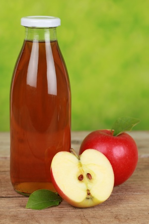 Apple juice in a bottle decorated with ripe apples Stock Photo - 16690722