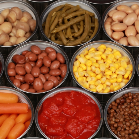 canned peas: Collection of canned vegetables such as corn, peas, beans and tomatoes Stock Photo