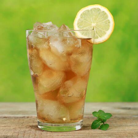 Ice tea with ice cubes and a lemon slice photo