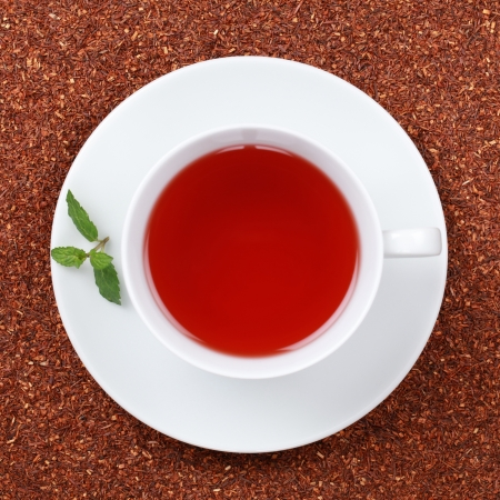 rooibos tea: Rooibos Tea in a cup, decorated with a mint