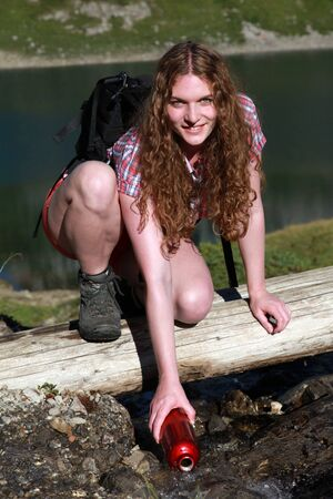 freetime activity: Bailing water from a brook in the mountains Stock Photo