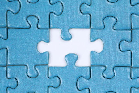 Jigsaw Puzzle with the last missing piece Stock Photo