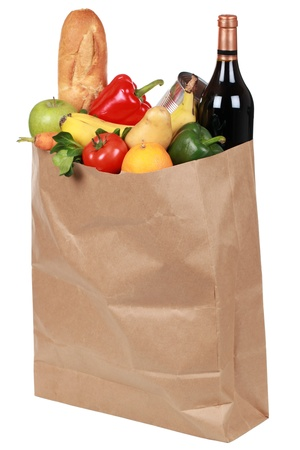 Groceries in a paper bag including fruits, vegetables and drinks