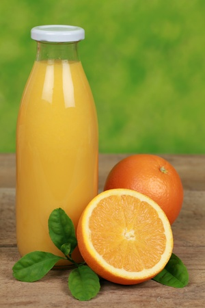 Fresh orange juice in a bottle and in a glass Stock Photo - 17570656