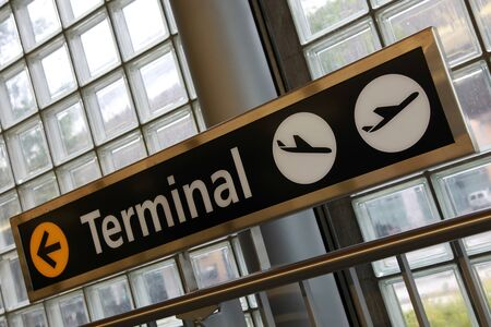airplane landing: Sign showing the way to the terminal building of an airport
