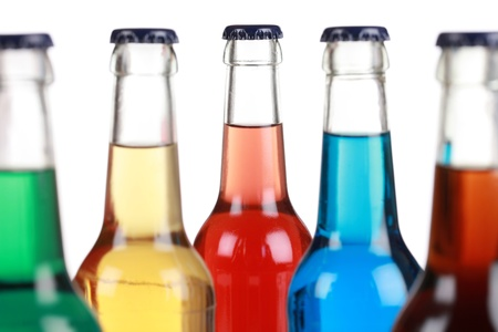 Glass bottles with soft drinks, isolated on a white background
