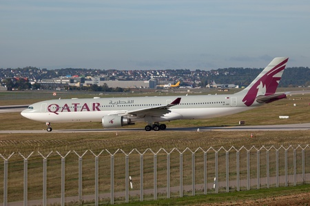 str: Stuttgart, Germany - October 5, 2012: A Qatar Airways Airbus A330-300 with the registration A7-AED taxis at Stuttgart airport (STR).  Editorial