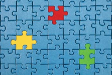 Jigsaw Puzzle with missing pieces in three different colors photo