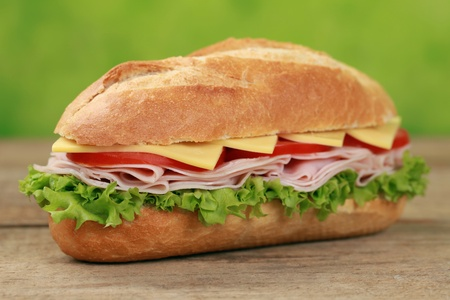 Sub Sandwiches with ham, cheese, tomatoes and lettuce  Stock Photo