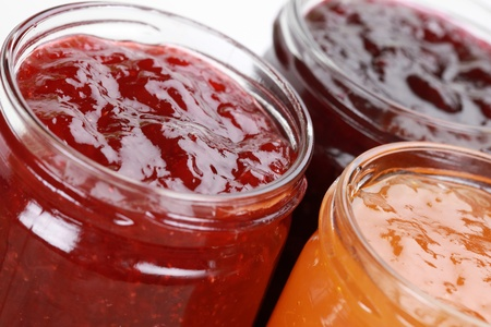 Marmalade jars with jam made from strawberries, cherries and apricots